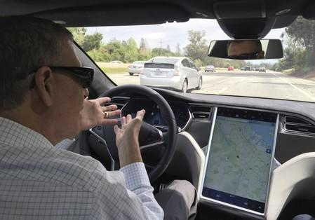 Reuters journalist ngrassia sits in the drivers seat of a Tesla S-Type in Autopilot mode in San Francisco