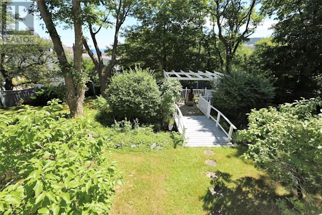 <p><span>1 Bonaventure Ave., St. John's, Nfld.</span><br> The gardens are private and mature, and can be accessed from the walkout basement.<br> (Photo: Zoocasa) </p>
