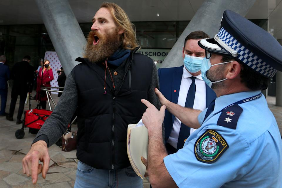 The protester was walked away by police but was let go soon after. Source: Getty