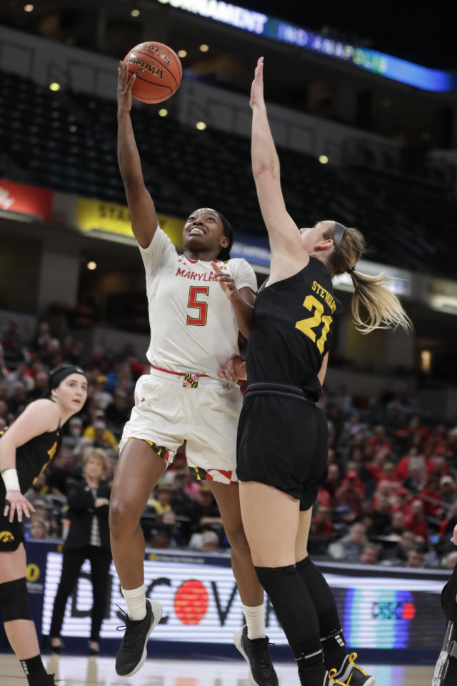 Maryland guard Kaila Charles (5) shoots over Iowa forward Hannah Stewart (21) in the first half of an NCAA college basketball championship game at the Big Ten Conference women's tournament in Indianapolis, Sunday, March 10, 2019. (AP Photo/Michael Conroy)