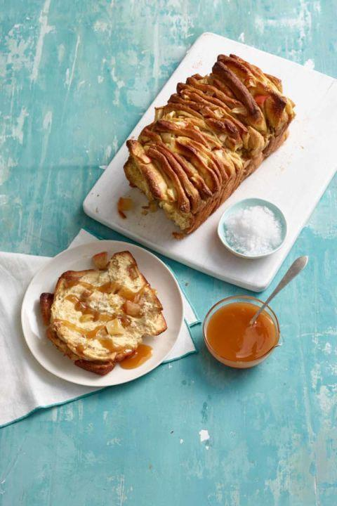 """<p>Cinnamon bread gets a special-event touch when topped with caramel sauce and a dusting of coarse salt to accentuate the sweetness.  </p><p><strong><a rel=""""nofollow"""" href=""""http://www.womansday.com/food-recipes/food-drinks/recipes/a12431/apple-cinnamon-pull-apart-bread-recipe-wdy0315/"""">Get the recipe.</a> </strong><br></p>"""