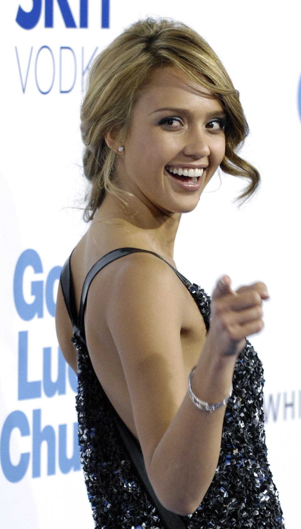 """Jessica Alba, a cast member in the film """"Good Luck Chuck,"""" turns back for photographers at the premiere of the film in Los Angeles, Wednesday, Sept. 19, 2007. (AP Photo/Chris Pizzello)"""