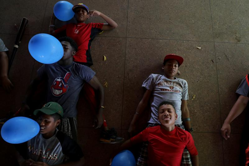 Baseball little league players Ibrahim Ruiz, 13 (bottom right), and Adrian Salcedo, 13 (top right), take part in a psychological therapy session at Diamonds Prospect baseball academy in Maracaibo, Venezuela. (Photo: Manaure Quintero/Reuters)