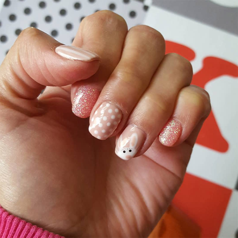 "<p>Stripes, shimmer, polka dots, and an adorable bunny make up this cute Easter nail art. (Photo: <a rel=""nofollow"" href=""https://www.instagram.com/p/BSbD5UqASqh/"">Instagram/alicia.90</a>) </p>"