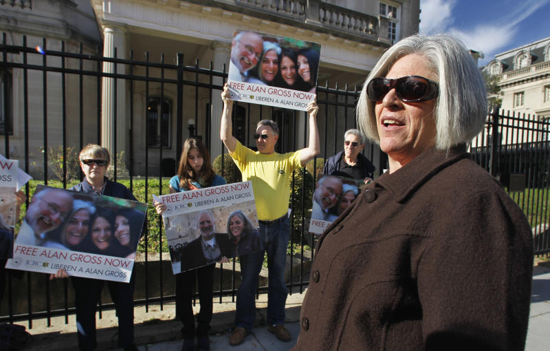 "FILE - In this Nov. 28, 2011 file photo, Judy Gross, the wife of imprisoned American Alan Gross, right, takes part in a rally to support her husband, outside the Cuban Interests Section in Washington D.C. Judy Gross, who recently returned from a trip to Cuba to see her husband said Tuesday, Sept. 11, 2012, that she is fearful he will not survive his long incarceration. She begged Cuban President Raul Castro to ""put an end to our anguish and let Alan come home."" (AP Photo/Manuel Balce Ceneta, File)"