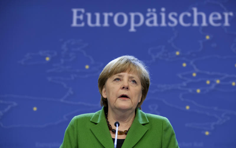 German Chancellor Angela Merkel speaks during a media conference at an EU summit in Brussels on Thursday, March 14, 2013. European Union heads of state and government meet for a two-day summit, beginning Thursday, to discuss the current financial crisis. (AP Photo/Virginia Mayo)