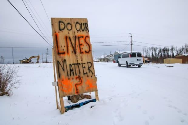 A sign in Neskantaga First Nation, where people have been living with a long-term drinking water advisory for 26 years. (Olivia Stefanovich/CBC - image credit)