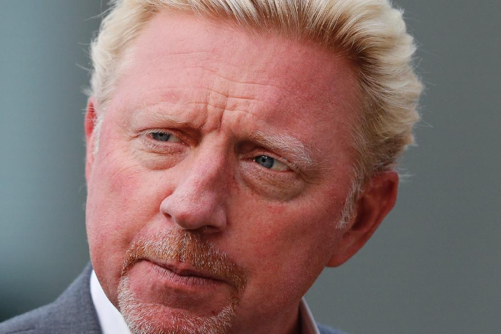 German former tennis player Boris Becker gives a media interview on the eleventh day of the 2017 Wimbledon Championships at The All England Lawn Tennis Club in Wimbledon, southwest London, on July 14, 2017. (AFP Photo/Adrian DENNIS)