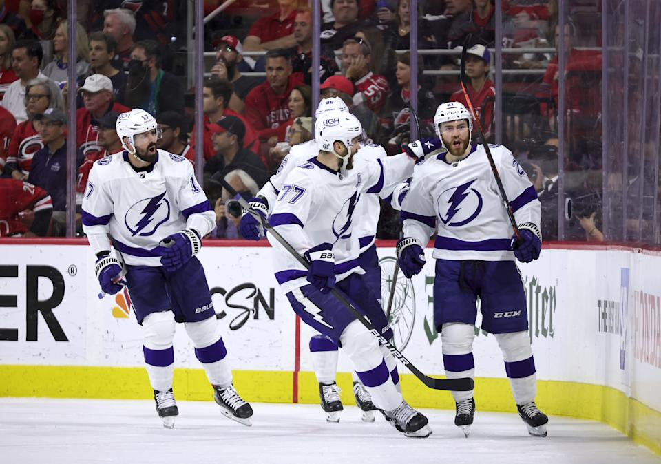 RALEIGH, NC - JUNE 8: Brayden Point #21of the Tampa Bay Lightning scores a goal and celebrates with teammates in Game Five of the Second Round of the 2021 Stanley Cup Playoffs against the Carolina Hurricanes on June 8, 2021 at PNC Arena in Raleigh, North Carolina. (Photo by Gregg Forwerck/NHLI via Getty Images)