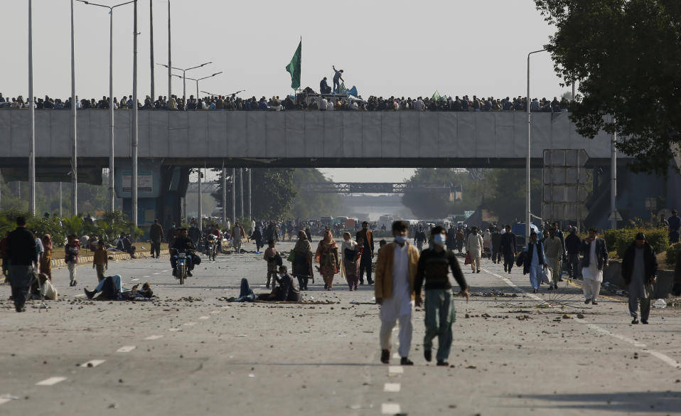 Supporters of Tehreek-e-Labaik Pakistan, a religious political party, block a main highway during an anti-France rally in Islamabad, Pakistan, Monday, Nov. 16, 2020. The supporters are protesting the French President Emmanuel Macron over his recent statements and the republishing in France of caricatures of the Muslim Prophet Muhammad they deem blasphemous. (AP Photo/Anjum Naveed)