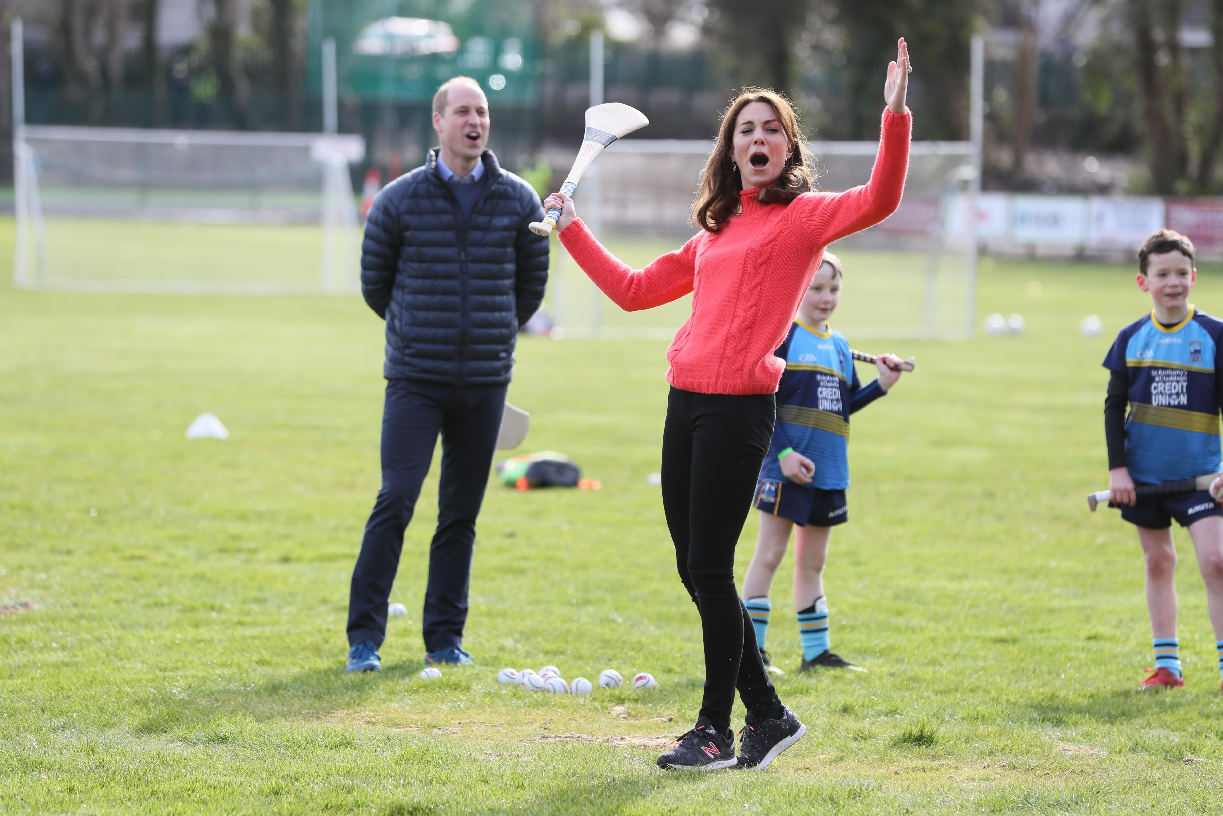 The Duke and Duchess of Cambridge try out hurling during a visit to a local Gaelic Athletic Association (GAA) club to learn more about traditional sports during the third day of their visit to the Republic of Ireland. (Photo by Brian Lawless/PA Images via Getty Images)