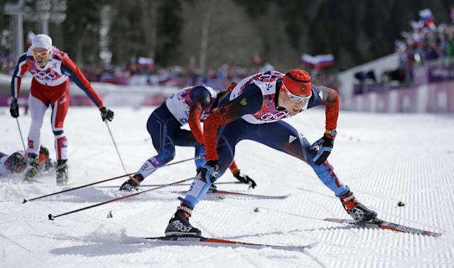 Russia's Alexander Legkov crosses the finish to win the gold medal in the men's 50K cross-country race at the 2014 Winter Olympics, Sunday, Feb. 23, 2014, in Krasnaya Polyana, Russia. (AP Photo/Gregorio Borgia)