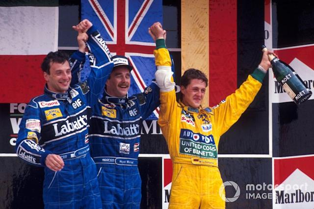 "Podium : le second Riccardo Patrese, Williams, le vainqueur Nigel Mansell, Williams, le troisième Michael Schumacher, Benetton <span class=""copyright"">Sutton Motorsport Images</span>"