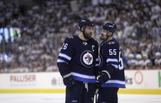 Winnipeg Jets' Blake Wheeler (26) and Mark Scheifele (55) talk to each other during a time stoppage during second period NHL Western Conference Finals game 5 hockey action against the Vegas Golden Knights, in Winnipeg, Sunday, (Trevor Hagan/The Canadian Press via AP)