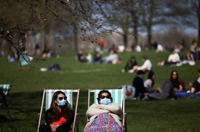FILE PHOTO: People relax during sunny weather in Hyde Park, amid the coronavirus disease (COVID-19) outbreak, in London
