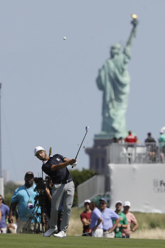 Abraham Ancer, of Mexico, hits from the third fairway in the final round in the Northern Trust golf tournament at Liberty National Golf Course, Sunday, Aug. 11, 2019, in Jersey City, N.J. (AP Photo/Mark Lennihan)