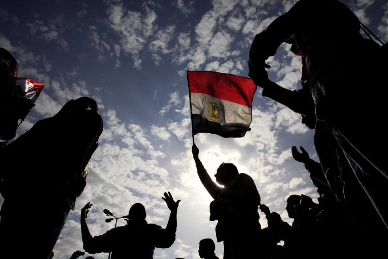 Egyptian anti-Mubarak protesters chant as they wave Egyptian flags during their protest in Cairo, Egypt, Sunday, Feb. 6, 2011. Egypt's largest opposition group, the Muslim Brotherhood, said it would begin talks Sunday with the government to try to end the country's political crisis but made clear it would insist on the immediate ouster of longtime authoritarian President Hosni Mubarak. (AP Photo/Amr Nabil)