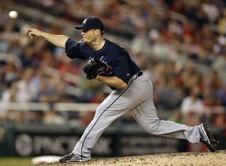 FILE PHOTO: Atlanta Braves relief pitcher Craig Kimbrel throws in the ninth inning of their MLB National League baseball game against the Washington Nationals in Washington August 6, 2013. REUTERS/Gary Cameron