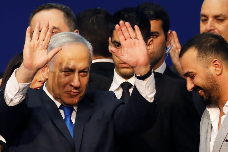 Israeli Prime Minister Benjamin Netanyahu gestures after speaking to supporters following the announcement of exit polls in Israel's election at his Likud party headquarters in Tel Aviv