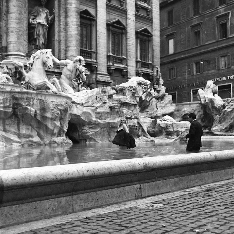 Film set of 'La Dolce Vita' at Trevi Fountain while the actor Marcello Mastroianni and the actress Anita Ekberg take a bath in the 'Trevi fountain', Rome 1959. (Photo by Archivio Cicconi/Getty Images)
