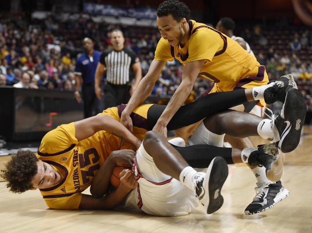 Arizona State's Taeshon Cherry, left, and Arizona State's Jaelen House, right, scramble for the ball against St. John's Marcellus Earlington during the second half of an NCAA college basketball game, Saturday, Nov. 23, 2019, in Uncasville, Conn. (AP Photo/Jessica Hill)