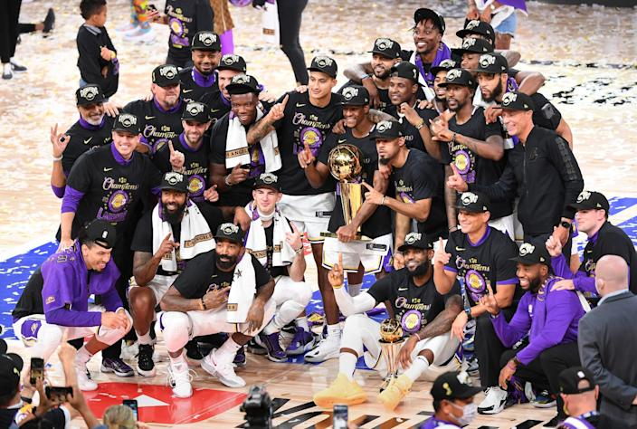 Lakers players celebrate their NBA championship victory over the Miami Heat on Sunday.