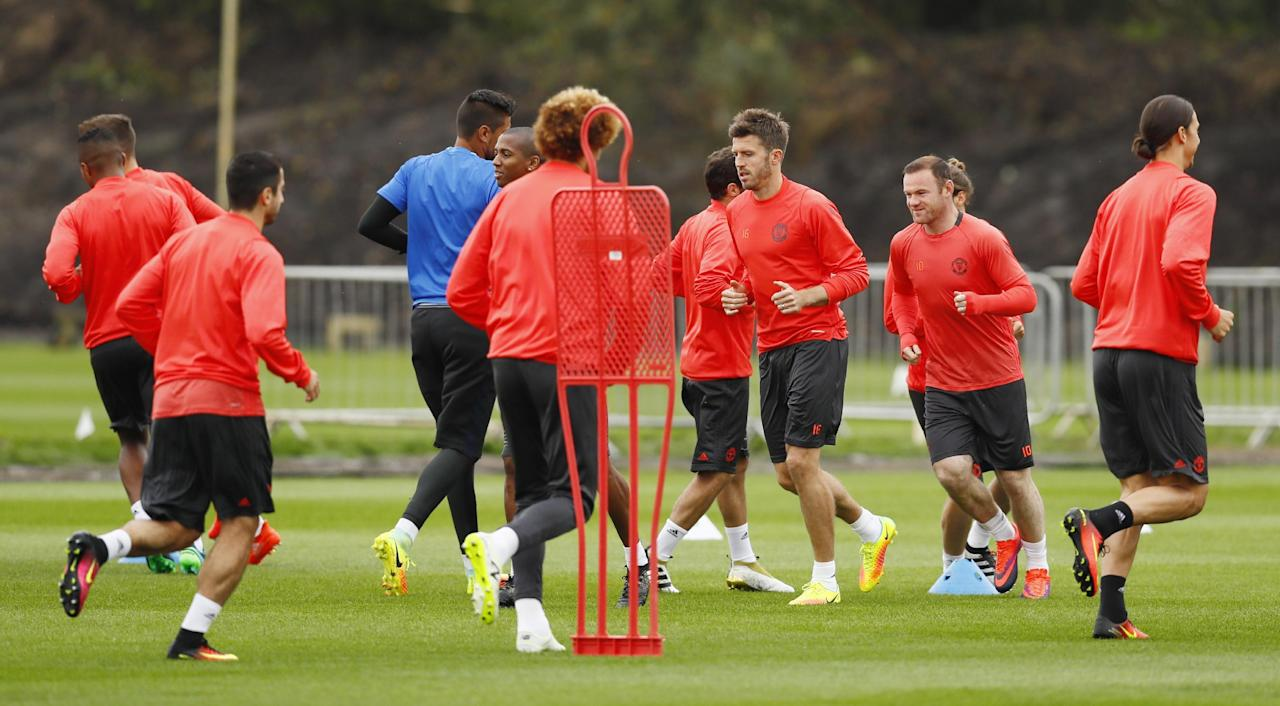 Britain Soccer Football - Manchester United Training - Manchester United Training Ground - 28/9/16 Manchester United's Michael Carrick and Wayne Rooney during training Action Images via Reuters / Jason Cairnduff Livepic EDITORIAL USE ONLY.