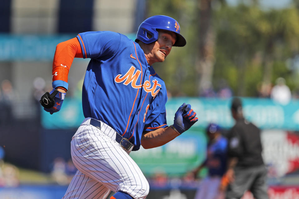 New York Mets' Brandon Nimmo rounds third and heads home to score on a single by Dominic Smith during the first inning of a spring training baseball game against the St. Louis Cardinals Friday, Feb. 28, 2020, in Port St. Lucie, Fla. (AP Photo/Jeff Roberson)