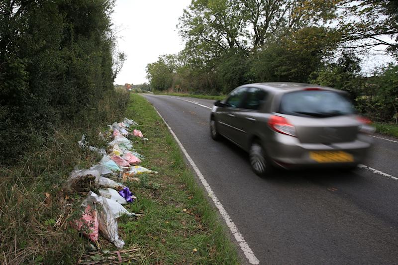 Floral tributes lay on the roadside near RAF Croughton in Northamptonshire, central England on October 10, 2019, at the spot where British motorcyclist Harry Dunn was killed as he travelled along the B4031 on August 27. - Dunn was killed on August 27 when his motorbike collided with a car near a Royal Air Force base in Northamptonshire in central England, which is used by the US military as a communications hub. (Photo by Lindsey Parnaby / AFP) (Photo by LINDSEY PARNABY/AFP via Getty Images)