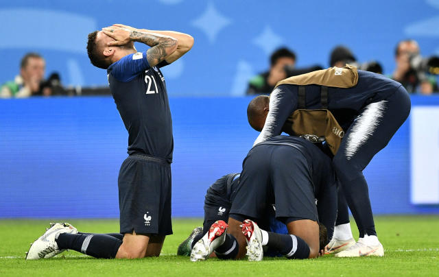<p>France's Lucas Hernandez, left, celebrates after his team advanced to the final after the semifinal match between France and Belgium at the 2018 soccer World Cup in the St. Petersburg Stadium in St. Petersburg, Russia, Tuesday, July 10, 2018. (AP Photo/Martin Meissner) </p>