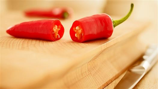 "<div class=""caption-credit""> Photo by: Adam Gault</div><div class=""caption-title""></div><b>Peppers</b> <br> Whether hot and spicy or sweet and crunchy, there are enough peppers out there to suit anyone's taste, and they're all equally healthy for you. Spicy chile peppers have high levels of capsaicin, which interferes with your mind's pain receptors, and therefore act as natural painkillers. Capsaicin, which gives peppers their heat, has also been found to aid in weight loss by keeping your metabolism in check. Sweet peppers have a similar compound called dihydrocapsiate that comes without the spicy kick of capsaicin but with the same effects on pain and weight loss. They also contain loads of vitamin C and beta-carotene. Toss a few spicy peppers into your next batch of tacos or Asian stir-fry; bell peppers retain most of their vitamins when eaten raw. <p>   <b> </b> <b><a rel=""nofollow"" href=""http://wp.me/p1rIBL-1JK"">The Calories in Watermelon</a></b><a rel=""nofollow"" href=""http://wp.me/p1rIBL-1JK""><br></a> </p>"