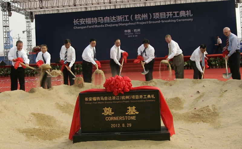 Ford Asia Pacific chief Joe Hinrichs far left, and Ford Motor Co. President and CEO Alan Mulally, third right, with local government and company officials attend the Ford Hangzhou project groundbreaking ceremony in Hangzhou, China, Wednesday Aug. 29, 2012. Ford Motor Co. is developing a lower-priced small car for the Chinese market but has no plans to start a separate, cheaper brand in China as rivals General Motors and Volkswagen have. (AP Photo)