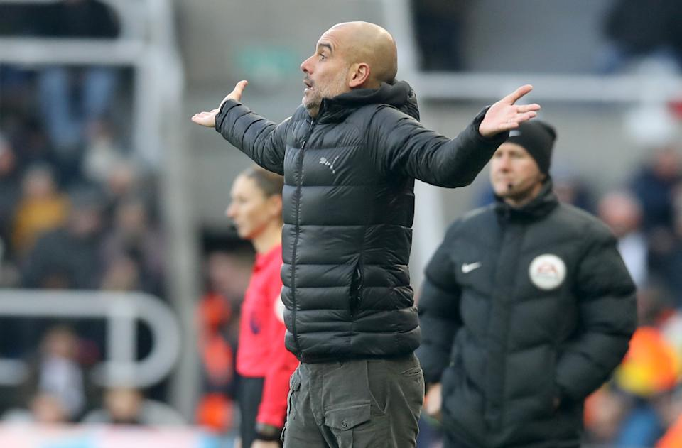 A frustrated Pep Guardiola sees his side lose more ground in the title race. (Photo by Owen Humphreys/PA Images via Getty Images)