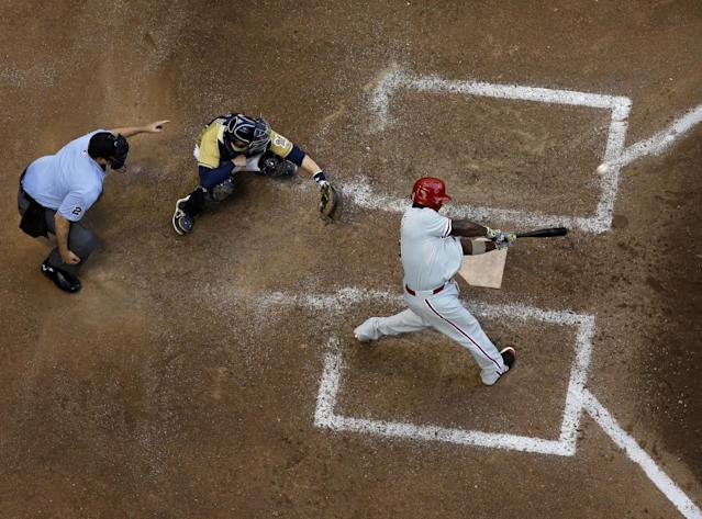 Philadelphia Phillies' Ryan Howard hits a two-run scoring double during the eighth inning of a baseball game against the Milwaukee Brewers Thursday, July 10, 2014, in Milwaukee. (AP Photo/Morry Gash)
