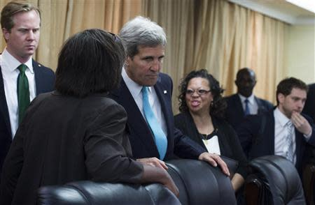 U.S. Secretary of State John Kerry (3rd L) speaks with aides prior to a meeting with South Sudan's President Salva Kiir at the President's Office in Juba