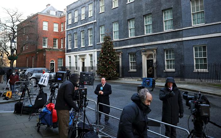 The press are gathered outside 10 Downing Street in anticipation of a statement - REUTERS/HENRY NICHOLLS