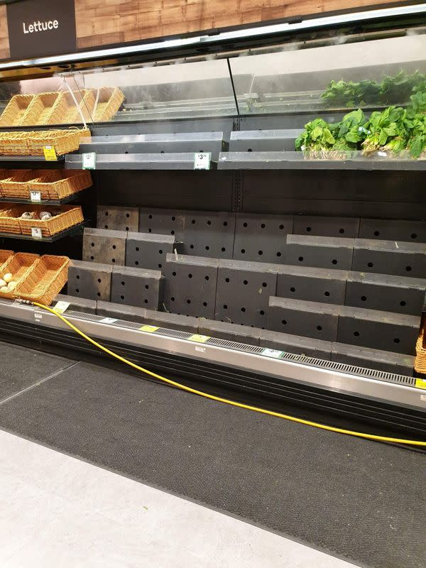 Near empty shelves are seen at a supermarket in Melbourne