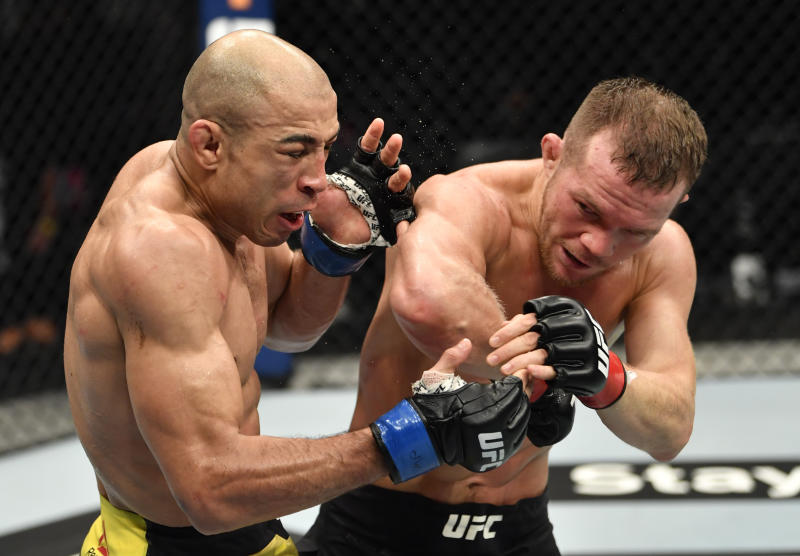 ABU DHABI, UNITED ARAB EMIRATES - JULY 12: (R-L) Petr Yan of Russia elbows Jose Aldo of Brazil in their UFC bantamweight championship fight during the UFC 251 event at Flash Forum on UFC Fight Island on July 12, 2020 on Yas Island, Abu Dhabi, United Arab Emirates. (Photo by Jeff Bottari/Zuffa LLC)