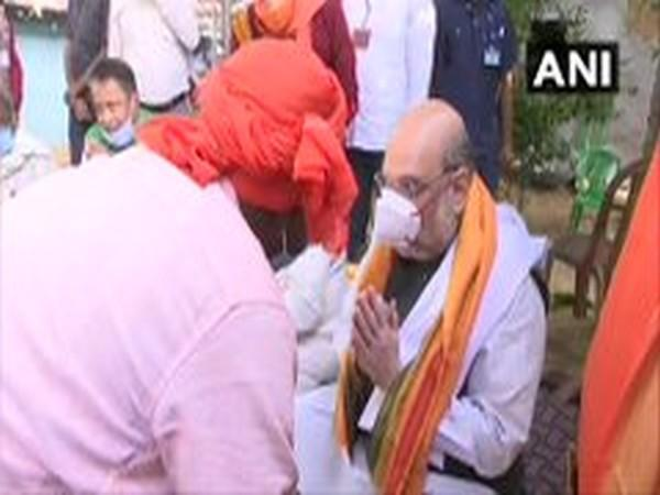 Union Home Minister Amit Shah meets a villager in West Bengal on Thursday. (ANI/Photo)