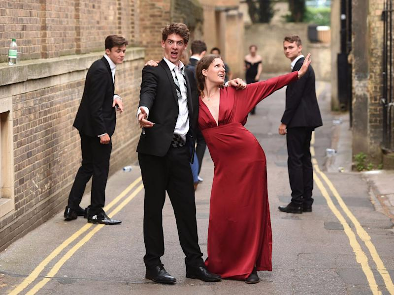 Students from Cambridge University make their way home after celebrating the end of the academic year at the May Balls.
