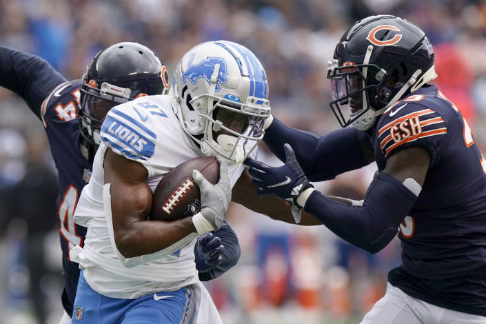 Detroit Lions wide receiver Quintez Cephus advances the ball as Chicago Bears cornerback Jaylon Johnson comes up to make the tackle during the first half of an NFL football game Sunday, Oct. 3, 2021, in Chicago. (AP Photo/Nam Y. Huh)