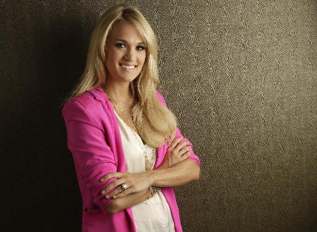 FILE-This April 19, 2012 file photo shows Carrie Underwood in Nashville, Tenn. The American country music star is dealing with a backlash, after telling a British newspaper that she supported gay marriage Wednesday, June 20, 2012. (AP Photo/Mark Humphrey)