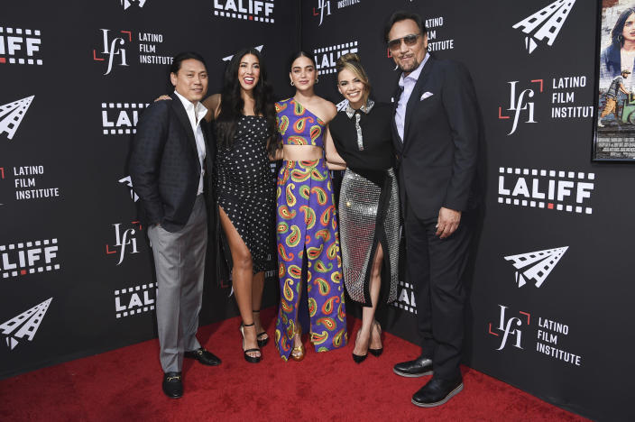 """Jon M. Chu, Stephanie Beatriz, Melissa Barrera, Leslie Grace and Jimmy Smits, from left, arrive at a screening of """"In the Heights"""" during the Los Angeles Latino International Film Festival at TCL Chinese Theatre on Friday, June 4, 2021, in Los Angeles. (Photo by Richard Shotwell/Invision/AP)"""