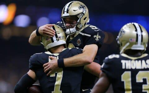 <span>Drew Brees celebrates with Taysom Hill after leading the Saints on a game-winning drive</span> <span>Credit: Getty Images </span>