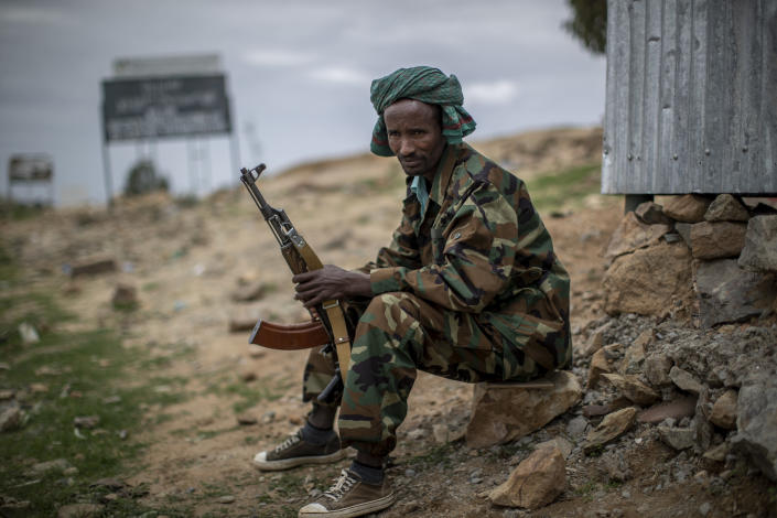 FILE - In this Friday, May 7, 2021 file photo, a fighter loyal to the Tigray People's Liberation Front (TPLF) mans a guard post on the outskirts of the town of Hawzen, then-controlled by the group but later re-taken by government forces, in the Tigray region of northern Ethiopia. The Tigray forces that in late June 2021 have retaken key areas after fierce fighting have rejected the cease-fire and vowed to chase out Ethiopian government forces and those of neighboring Eritrea. (AP Photo/Ben Curtis, File)