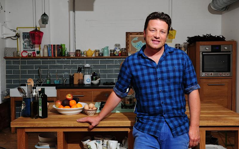 Jamie Oliver has blamed Brexit for the demise of his restaurant group - PA