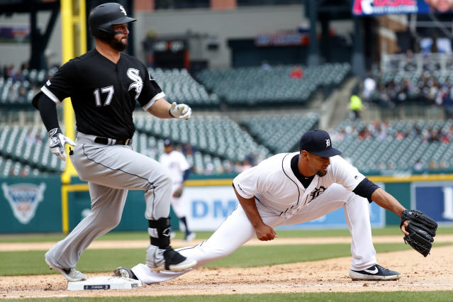 Chicago White Sox's Yonder Alonso (17) beats the throw to Detroit Tigers pitcher Tyson Ross, covering first base in the sixth inning of a baseball game in Detroit, Thursday, April 18, 2019. Niko Goodrum was charged with an error on the play. (AP Photo/Paul Sancya)