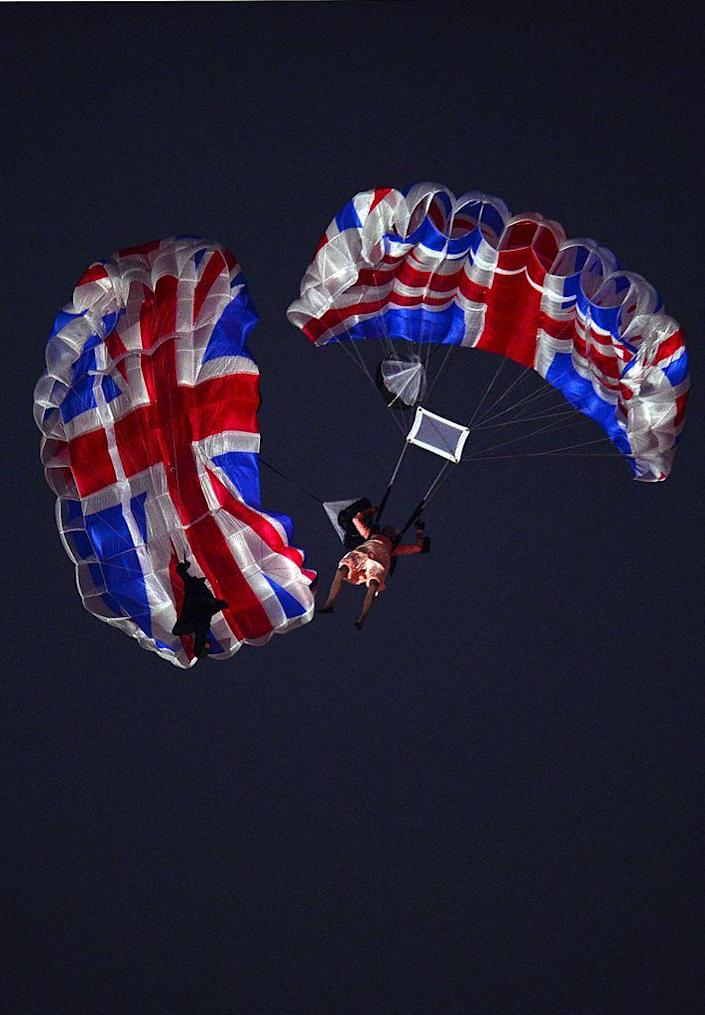 """<p>Though the evening was filled with many spectacles, one of the most memorable was the parachuting """"Queen Elizabeth"""" and """"James Bond"""" performers.</p>"""