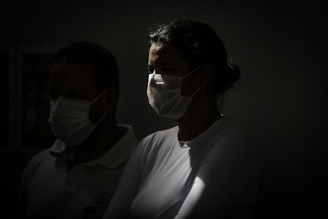 BRASILIA, BRAZIL - MARCH 13: A couple wearing protective masks at the Asa Norte Regional Hospital (HRAN) on March 13, 2020 in Brasilia, Brazil. According to the Health Ministry Brazil has confirmed 77 cases of coronavirus.