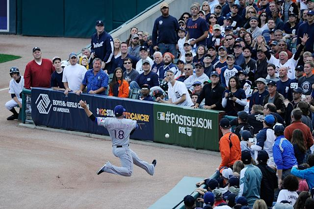 DETROIT, MI - OCTOBER 13: Mitch Moreland #18 of the Texas Rangers tries to catch a foul ball against the Detroit Tigers in Game Five of the American League Championship Series at Comerica Park on October 13, 2011 in Detroit, Michigan. (Photo by Kevork Djansezian/Getty Images)